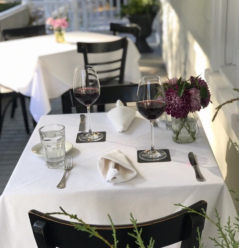 outdoor table with wine